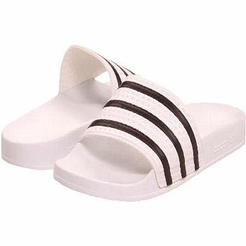 adidas Adilette (White/Black/White) Shoes adidas suggests ordering 2 whole sizes down from your reg